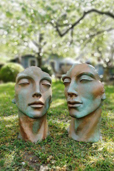 Gesicht Mann und Frau Kupfereffekt Steinguss