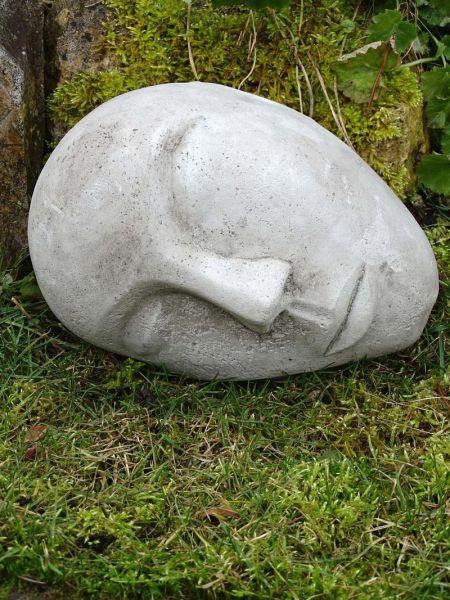 Gesicht aus Steinguss