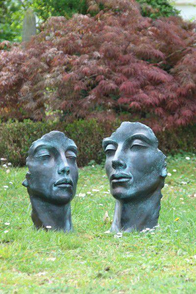 Gesicht Mann und Frau Bronzeeffekt Steinguss